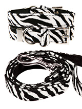 Zebra Print Fabric Collar & Lead Set - Our Faux Zebra collar and lead set is a contemporary animal print style and is right on trend. It is lightweight and incredibly strong. The collar has been finished with chrome detailing including the eyelets and tip of the collar. A matching harness and bandana are available to purchase separately....